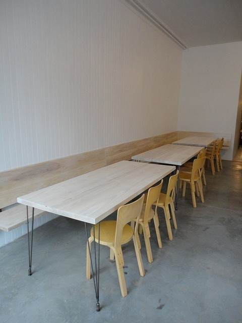Handmade tables and benches paired with Artek Aalto Birch Chair 66 (image by Julianne Jones)